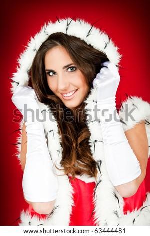 beautiful woman wearing santa claus clothes - stock photo