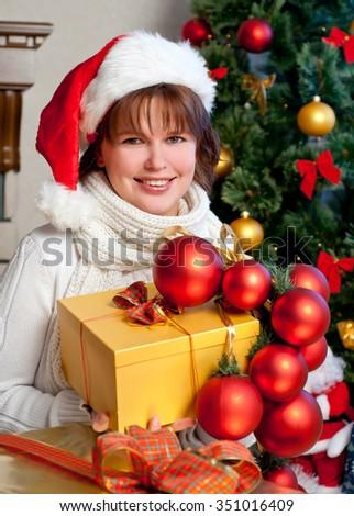 beautiful  woman wearing santa claus hat - stock photo