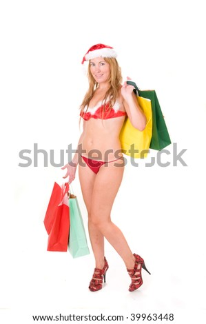 beautiful woman wearing santa claus lingerie with presents