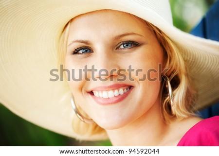 Beautiful woman wearing sun hat - stock photo