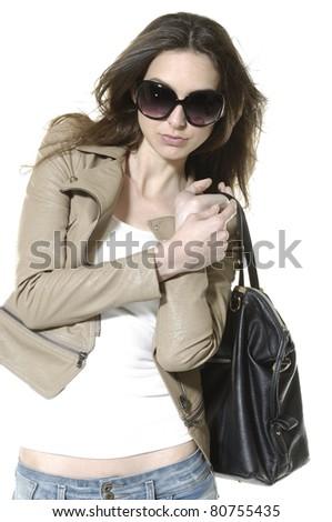 Beautiful woman wearing sunglasses holding handbag - stock photo