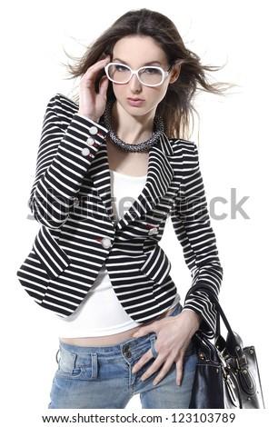 Beautiful woman wearing sunglasses with bag - stock photo