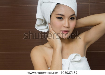 Beautiful woman wearing white towel in the bathroom