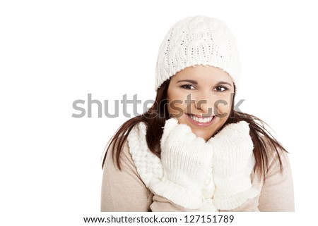 Beautiful woman wearing winter clothes over white background