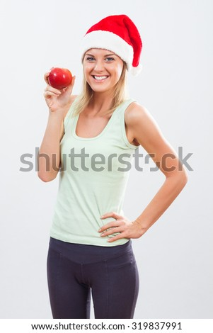 Beautiful woman will not have problems with her weight after holidays because she will continue to exercise and eat healthy.Healthy and fit for holidays - stock photo