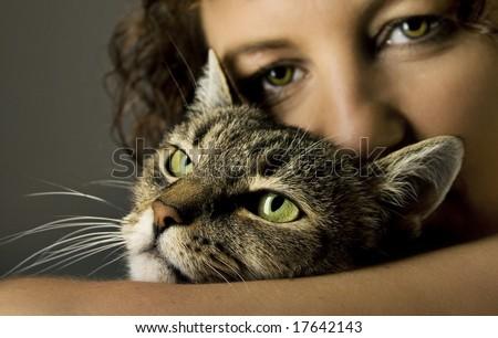 beautiful woman with a bautiful cat - stock photo