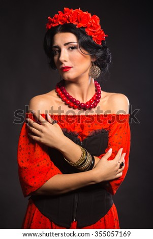 Beautiful woman with a beautiful red wreath.