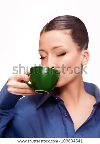 beautiful woman with a blue shirt drinking cup of coffee - stock photo