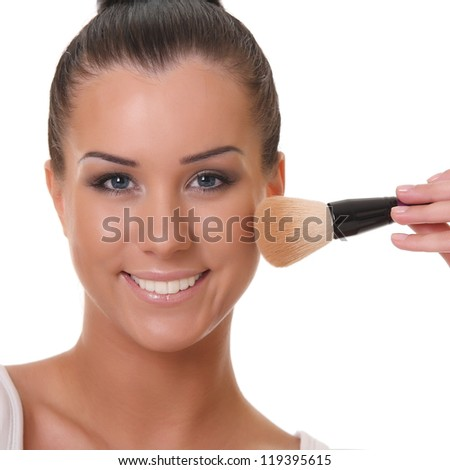 beautiful woman with a brush.on a white background - stock photo