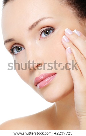 Beautiful woman with a calm view and the hand at face showing aging process of skin