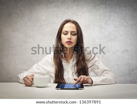 beautiful woman with a cup and tablet - stock photo