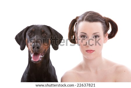 Beautiful woman with a doberman pincher to her side - stock photo