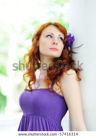 beautiful woman with a flower in her hairs - stock photo