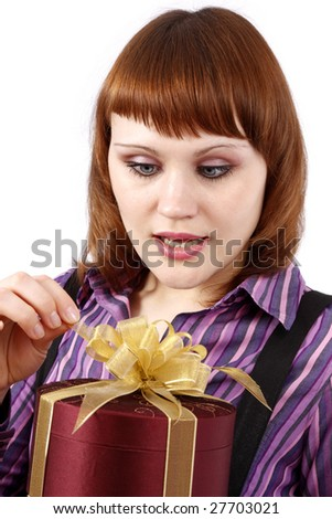Beautiful woman with a gift. Attractive girl holding purple box with gold ribbon. Woman is surprising at present. Isolated over white background. - stock photo