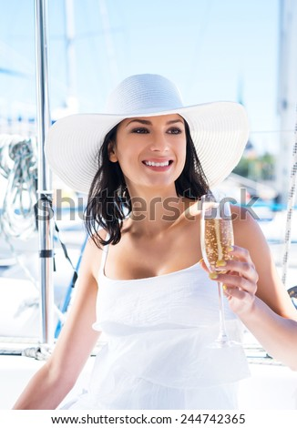 Beautiful woman with a glass of drink - stock photo