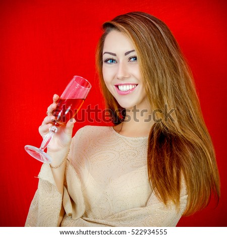 Beautiful woman with a glass of wine. Holiday. Celebratory cheerful mood