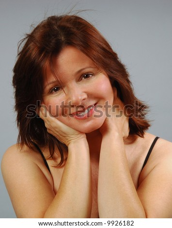 Beautiful woman with a happy expression of love - stock photo
