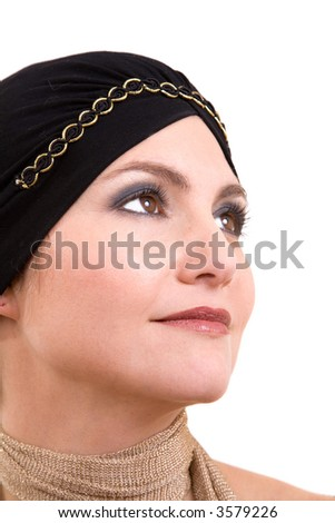 Beautiful woman with a headscarf looking up on white background - stock photo