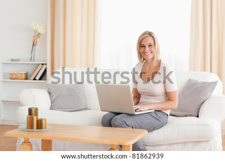 Beautiful woman with a laptop looking at the camera