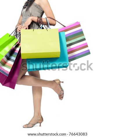 Beautiful woman with a lot of shopping bags - stock photo