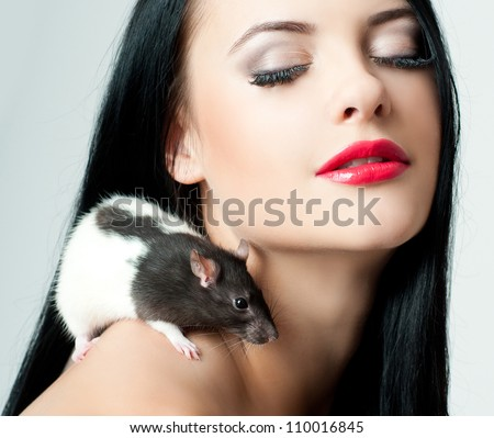 beautiful woman with a rat - stock photo