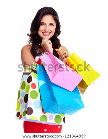 Beautiful woman with a shopping bag. Isolated on white. - stock photo
