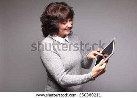 Beautiful woman with a tablet - stock photo