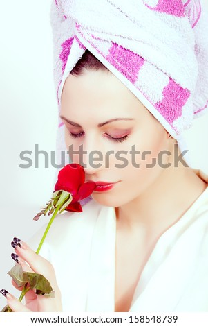 beautiful woman with a towel around her head - stock photo