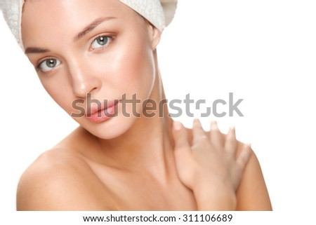 Beautiful woman with a towel on his head  - stock photo