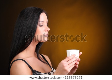 beautiful woman with an aromatic coffee in hands - stock photo