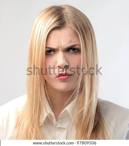 Beautiful woman with angry expression - stock photo