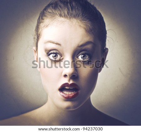Beautiful woman with astonished expression - stock photo