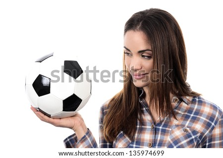 Beautiful woman with ball over white background - stock photo