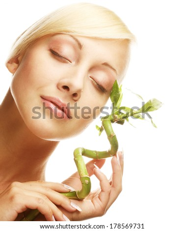 beautiful woman with bamboo - stock photo