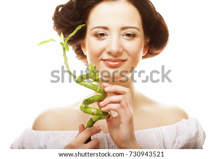 beautiful woman with bamboo isolated  on white background