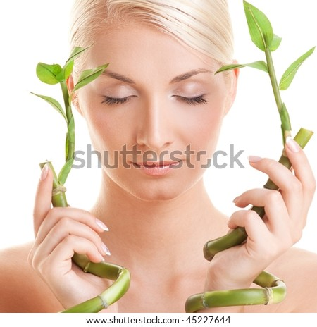 Beautiful woman with bamboo plant - stock photo