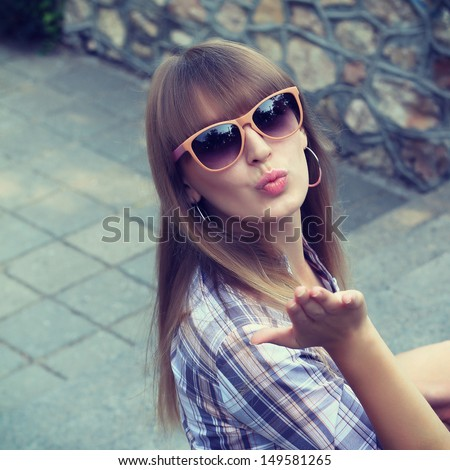 Beautiful woman with bangs. pictures in warm colors - stock photo