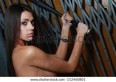 beautiful woman with baseball bat portrait .Erotic art photo. - stock photo