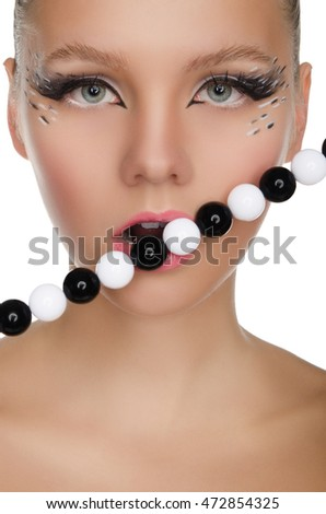 beautiful woman with black and white beads isolated on white