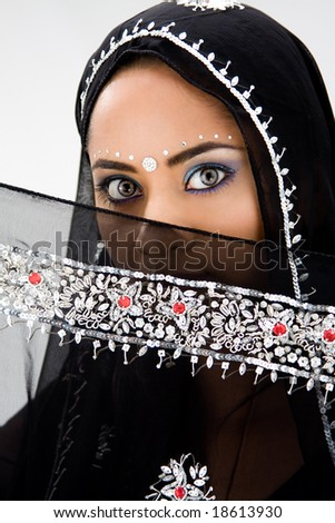 Beautiful woman with black head scarf, isolated - stock photo