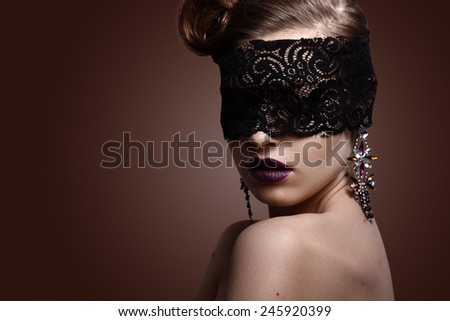 Beautiful Woman with Black Lace mask over her Eyes. Sexy Lips. Makeup. Make up concept. Passion - stock photo