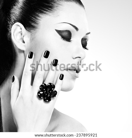 Beautiful  woman with black nails posing at studio - stock photo