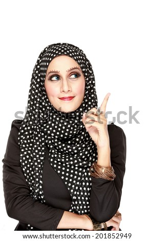 beautiful woman with black scarf looking up to copy space isolated on white background - stock photo