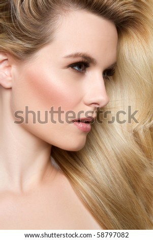 Beautiful woman with blond hair - stock photo