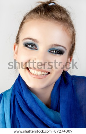 Beautiful woman with blue color scarf. - stock photo