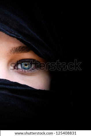 Beautiful woman with blue eyes wearing black scarf