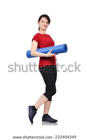Beautiful woman with blue mat for fitness - stock photo