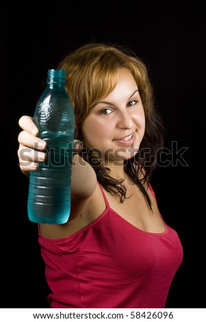 beautiful woman with bottle of water over black - stock photo