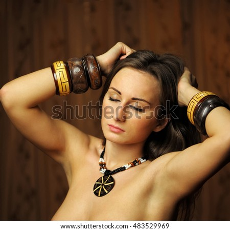 Beautiful woman with bracelets on hands
