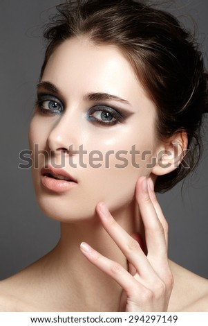 Beautiful woman with bright make up eye with sexy liner makeup. Fashion big arrow shape on woman's eyelid. Chic evening make-up, healthy face - stock photo